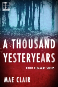 Book cover for A Thousand Yesteryears by Mae Clair has creepy dark forest at night at top with stark red bottom and lettering in white