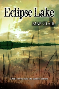 Book cover for Eclipse Lake by Mae Clair shows lake setting during summer with cattails in front, clouds reflected in water