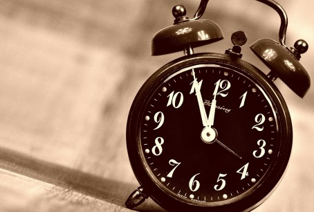 Alarm clock with bell alarms ticking down to midnight
