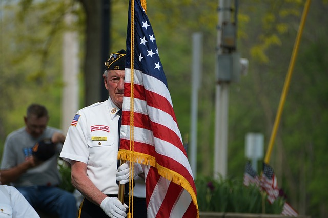 honor guard of man holding American flag