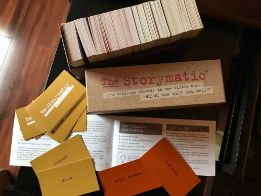 Storymatic, a card set for writers shows cards, box of cards, and instructions