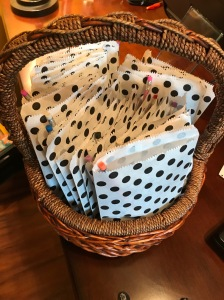 white paper bags with polka dots in a wicker basket