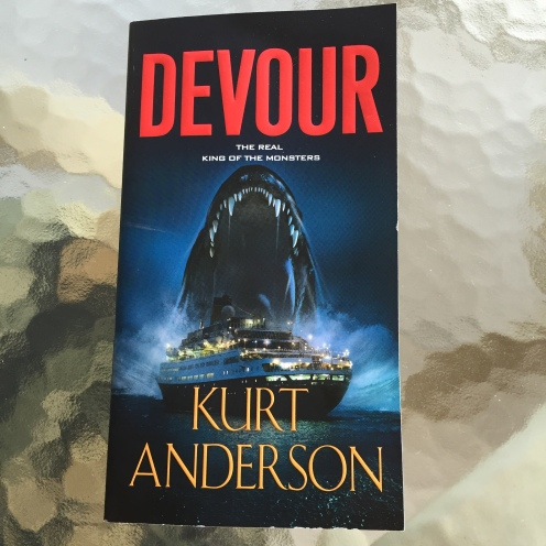 book cover for Devour by Kurt Anderson shows monster shark behind a cruise boat