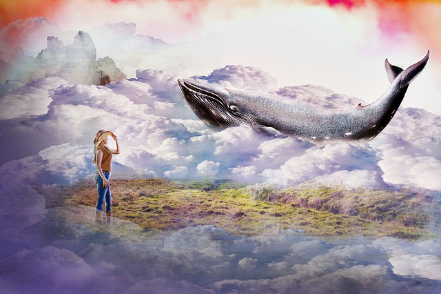 woman surrounded by clouds with a whimsical whale in he clouds