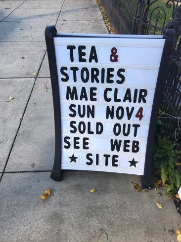Sidewalk sign advertising tea and stories with author Mae Clair--sold out