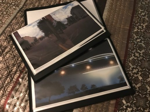 Open photo portfolios with photo rendering of a UFO and actual photographs of downtown Main Street in Point Pleasant West Virginia