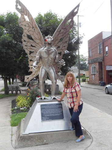 Author Mae Clair with statue of the Mothman in downtown Point Pleasant, West Virginia