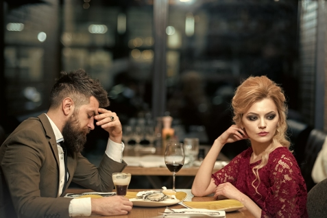 couple with misunderstanding at restaurant