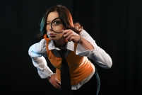 Young woman holding magnifying glass like detective