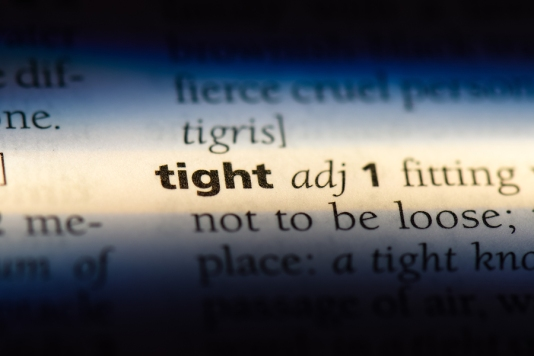 the word tight highlighted in a dictionary