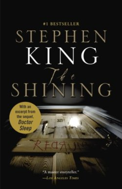 book cover for The Shining by Stephen King shows shot of an old wooden hotel room door looking up from floor with light striking wood and illuminating number 217, bloody letters scrawled on door