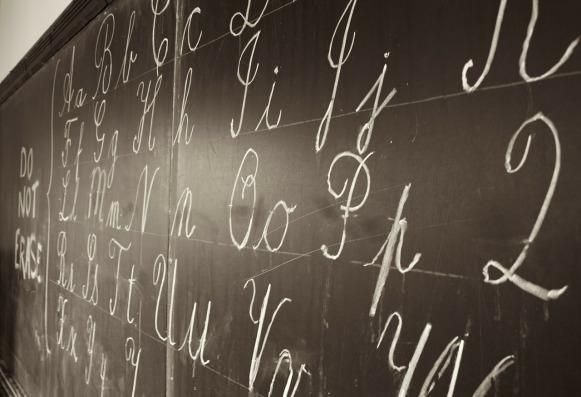 Cursive alphabet written on a school blackboard