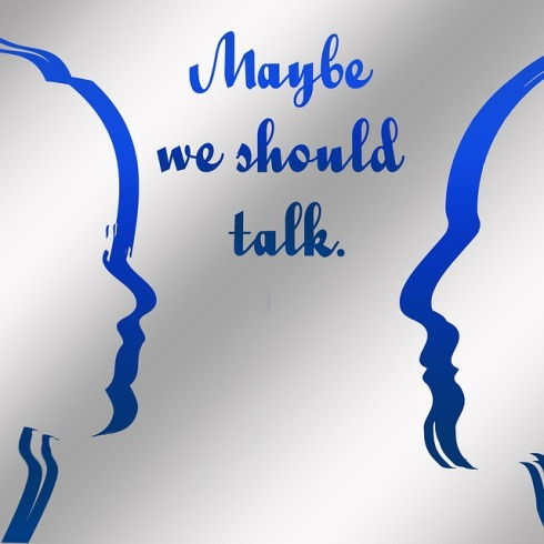 "conceptual sketch of two faces in profile with the words ""We should talk"" above"