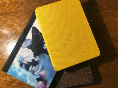 Three kindles with different colored covers