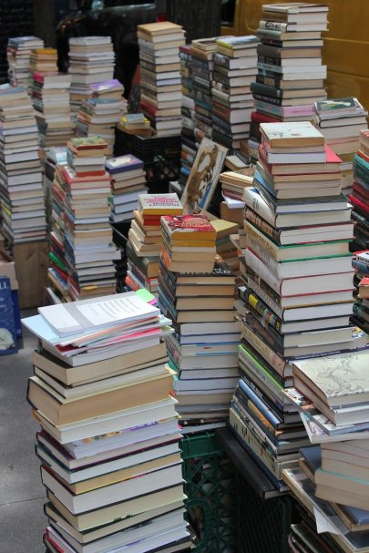towering piles of books lined up together
