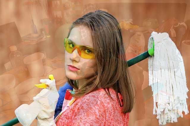 woman holding mop and cleaning disenfectant