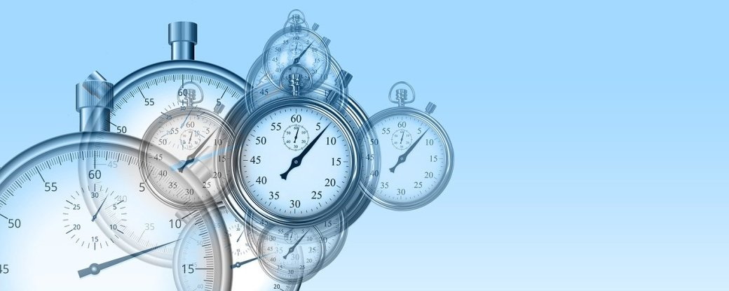 clocks and stopwatches on blue background